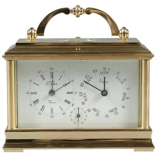 Reloj carruaje francés de doble esfera una para indicar la hora y la otra para calendario.  Data 1920.