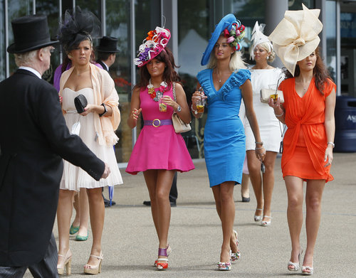 ORG XMIT: XAG120 Women wearing ornate outfits are seen in the parade ring on the second day of the Royal Ascot horse race meeting at Ascot, England, Wednesday, June, 15, 2011. Ascot  is celebrating its 300 years of horse racing at the Royal Racecourse, that began with Britain's Queen Anne spotting an open heath suitable for racing, the first race run in August 1711, with a prize of some 100 guineas. (AP Photo/Alastair Grant)