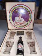 Set de botella y vasos del 75 aniversario de Coca Cola, 1977.