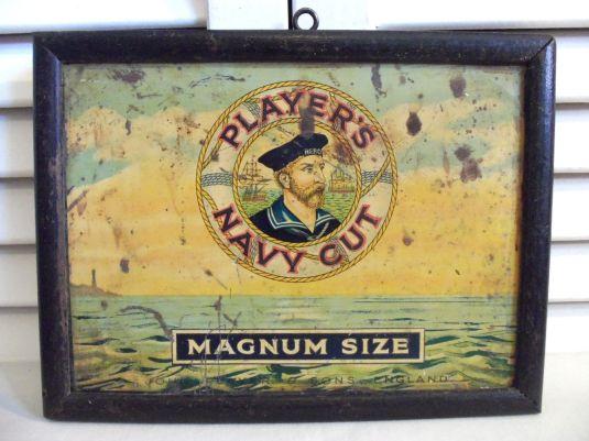 Cartel de latón y marco de madera. Inglaterra 1930.