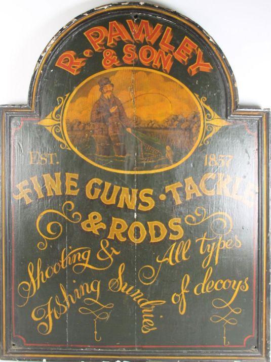 Cartel publicitando armas hecho en madera y pintado a mano. Inglaterra, 1857.