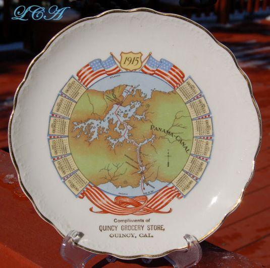 Calendario de 1915. Plato publicitario de porcelana del almacén Quincy California Grocery, Canal de Panamá.