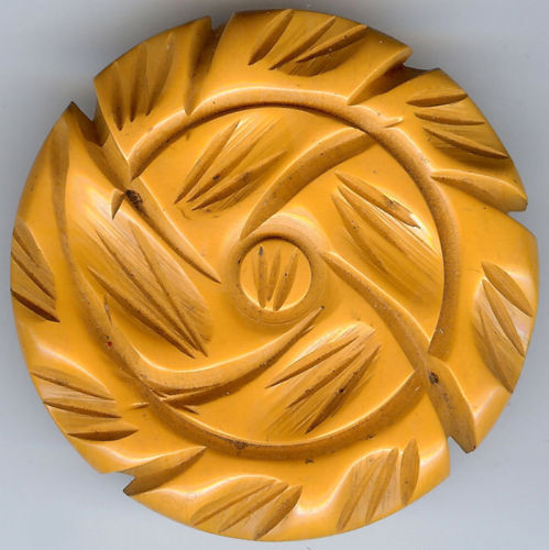 botones 1945 LARGE VINTAGE CARVED BUTTERSCOTCH BAKELITE WHIRLWIND BUTTON