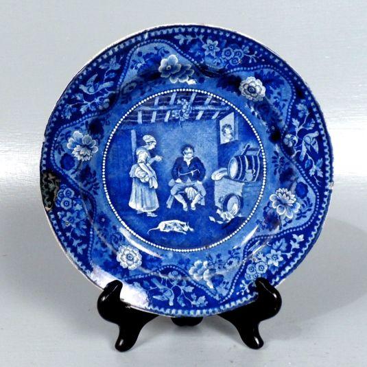 plato de porcelana inglesa sttanfordshire escena de El Quijote Sancho Panza discute con Teresa