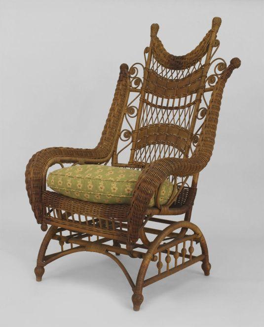mecedora 1900 1930 USA de mimbre y tapiz de tela en el asiento, fabricada por HEYWOOD BROS.