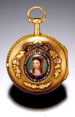 Reloj de bolsillo para dama elaborado en oro de 18K . Tiene esmaltado multicolor. Fue fabricado por Theodore Melly. Suiza 1810.