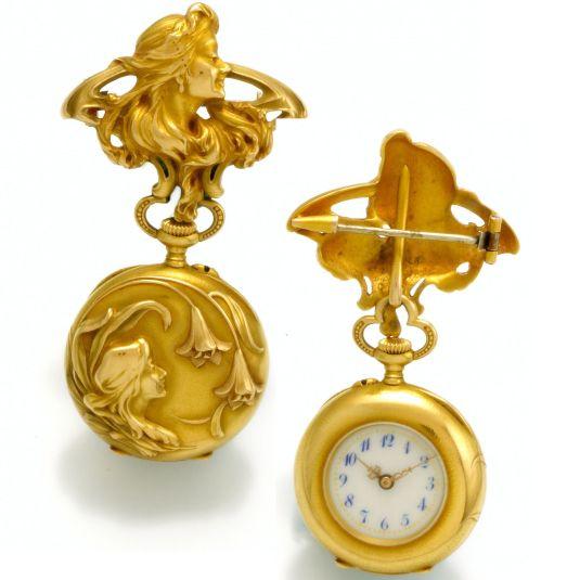 reloj de bolsillo oro de 18K repujado en estilo fabricado por Lapel Watch & Matching Suiza1909